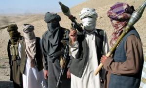 "Face-covered militants who they say are Talibans, pose with RPG and AK47, in Zabul province, southern of Kabul, Afghanistan Saturday, Oct. 7, 2006. A Taliban commander said in a sit-down interview that insurgent fighters will battle ""Christian"" troops until they leave Afghanistan and a fundamentalist government is established in Kabul, warning that hundreds of militants are ready to launch suicide attacks to again install strict Islamic law. (AP Photo/Allauddin Khan)"