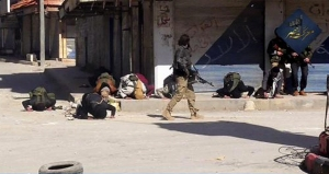 This image posted on the Twitter page of Syria's al-Qaida-linked Nusra Front on Saturday April 25, 2015, which is consistent with AP reporting, apparently shows fighters praying after rebel fighters from Islamic factions — including the Nusra Front captured the town of Jisr al-Shughour from Syrian government forces, in Idlib province, Syria. Hard-line Syrian rebel groups entered the strategic town Saturday in northwestern Syria, sending government troops fleeing after intense clashes that have seen them take nearly all of a crucial province. (Al-Nusra Front Twitter page via AP)