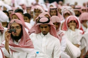Saudis attend a religious sermon at Rabwat Arriyadh in Riyadh, Saudi Arabia, Sunday, July 12, 2009. Saudi authorities have been poring over psychological profiles of terrorists and studies of how al-Qaida draws in recruits, looking for scientific ways to keep the kingdom's youth away from militancy. One new method they've hit on: segregated Islamic summer camps for the whole family. (AP Photo/Hassan Ammar)