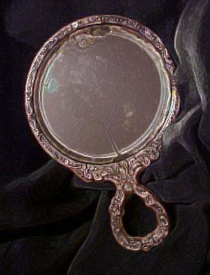 hand-held-ghost-mirror