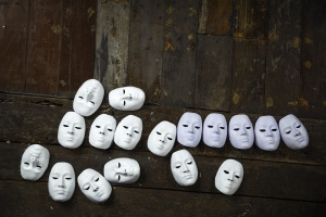 15417632 - abstract white masks on wooden background